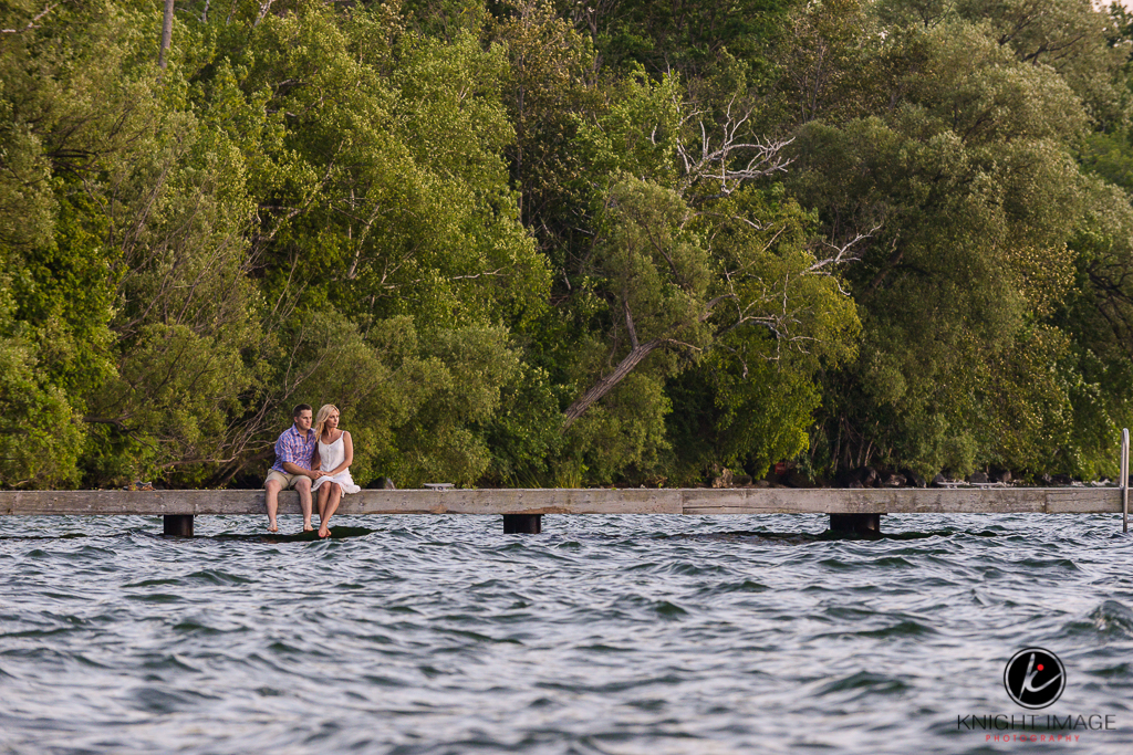 Keswick engagement photography on dock overlooking Cook's Bay in Keswick Ontario